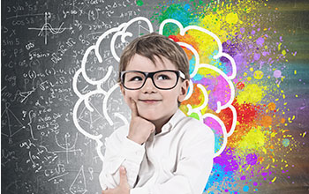 Little boy in glasses deep in thought, brain sketch, formulas and colorful patches in the background